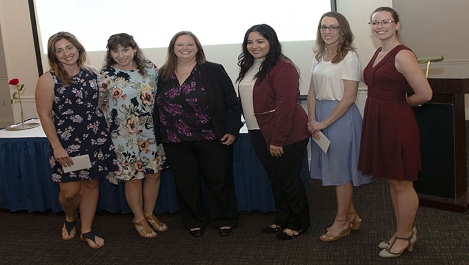 Spouses club awards $8,000 in scholarships - Family